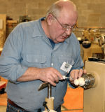 Tom Robinson demonstrated turned Christmas ornaments made from the previous year's tree